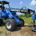 auger attachment for mini loader in action